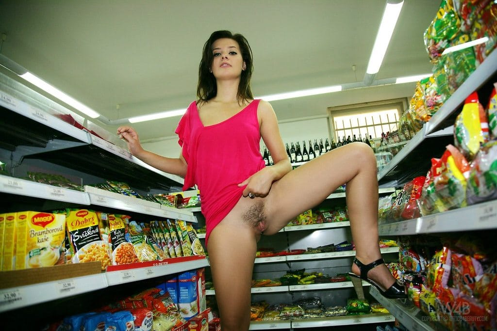 Naughty girl shows off her pussy in the local corner store.