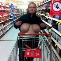 BBW Wife flashing her udders in the grocery store.