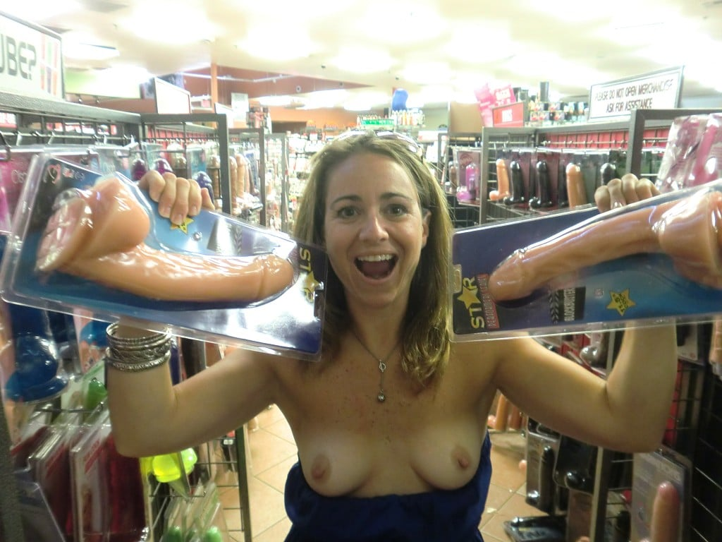 Hot wife flashing tits in adult toy store