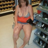 Woman shoe shopping and flashing pussy