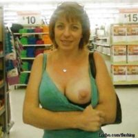 girl flashing one boob in Walmart