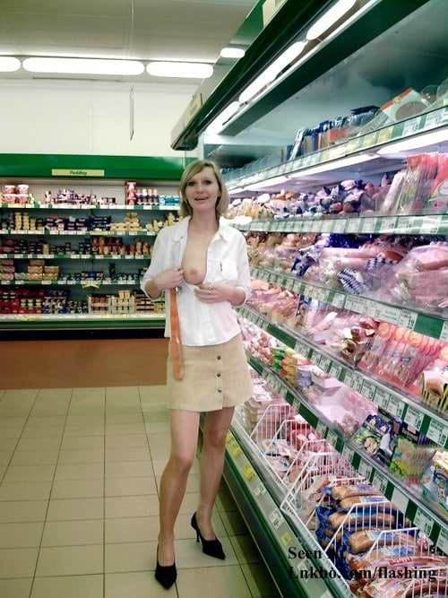 Girl flashing one tit in the grocery store