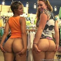 two girls flashing their asses in a store