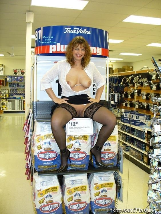 girl flashing in hardware store