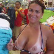 Woman flashing tits in crowded store