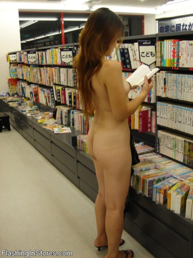 Woman shopping naked in a bookstore