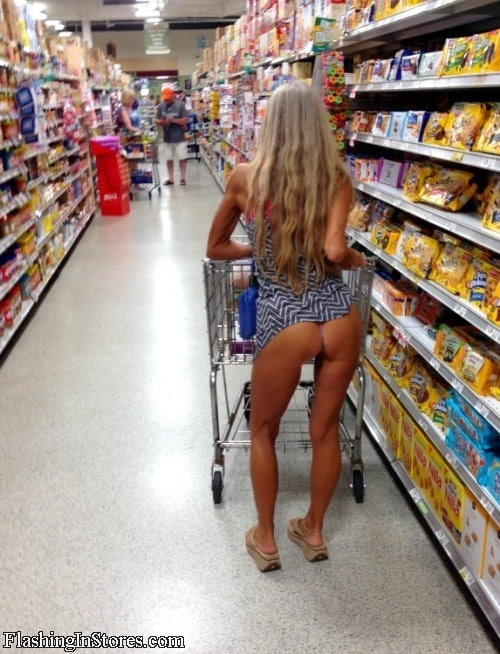 Fit wife flashing in a store.