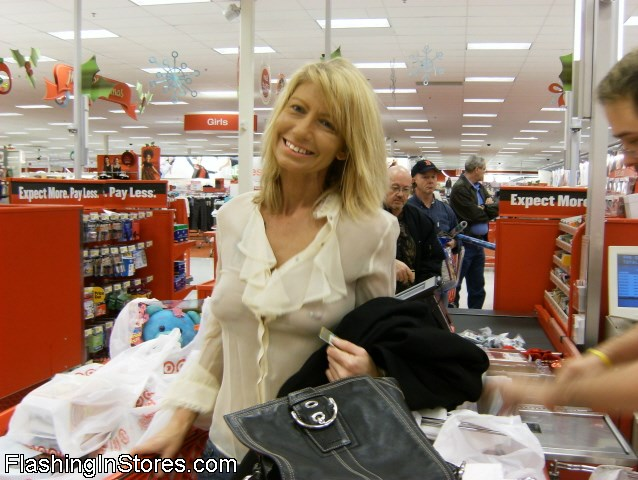 Hot wife in a see through shirt shopping