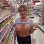 Annette Hotwife pulls up her shirt and flashes in Target