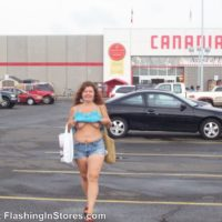 MILF flashing her tits in the store parking lot