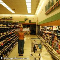 girl flashing her boobs in the beer aisle of the grocery store