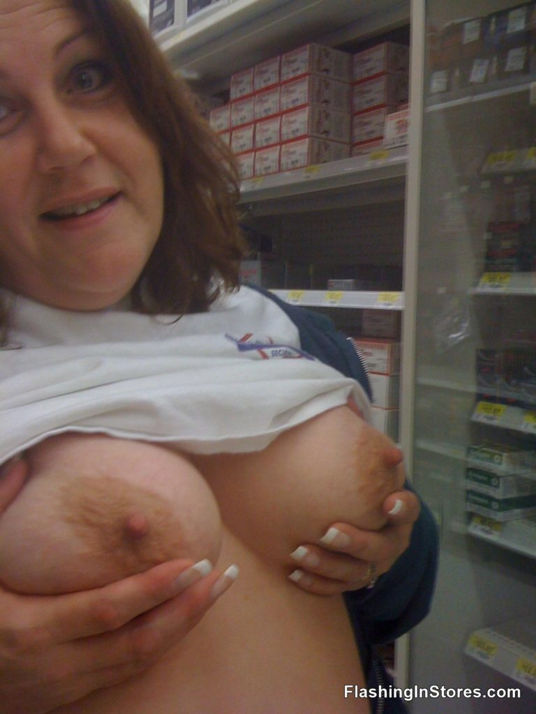 Sexy wife Beth showing off her boobs in public.