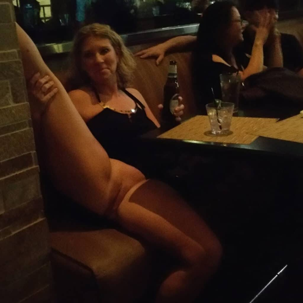 Swinging hotwife May showing off her pussy in a restaurant