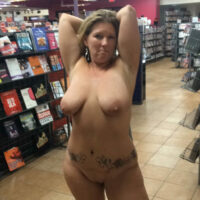 Hotwife May naked in an adult bookstore