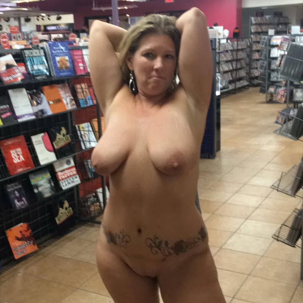 Sexy hot wife completely naked in the adult toy store