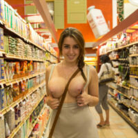 busty babe with her tits out flashing in the grocery store